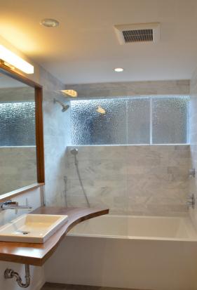 midcentury home, marble tile, live edge vanity